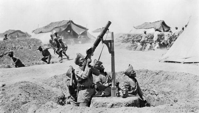 As other soldiers run for the cover of slit trenches, an Indian Lewis gun team engage an enemy aircraft in Mesopotamia, circa 1918