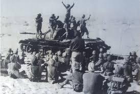 Indian soldiers doing Bhangara atop a captured Pakistani tank in Longewala.
