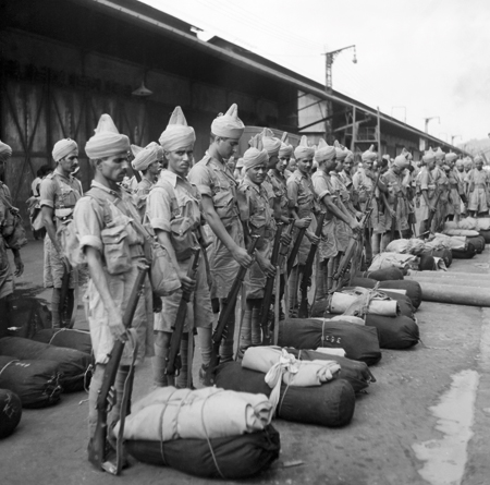 Newly-arrived Indian troops parade on the quayside at Singapore, November, 1941.