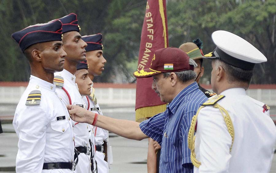 Union Defence Minister Manohar Parrikar reviewing the 128th Passing out Parade of National Defence Academy in Pune, Maharashtra on Saturday. PTI Photo (PTI5_30_2015_000113B)