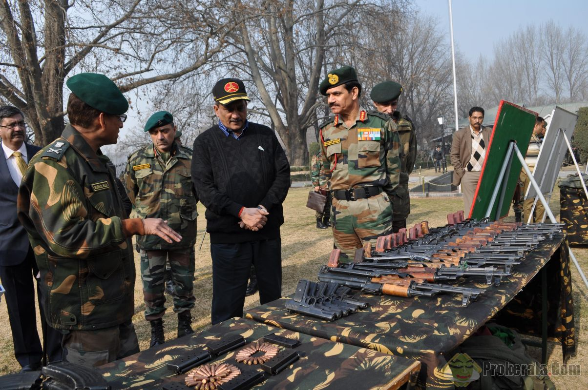 Defence Minister Manohar Parrikar inspects the weapons and ammunition